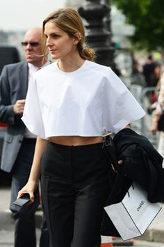 7/10/13: Gaia Repossi pairs a structured crop top with sleek black slacks. #LookOfTheDay