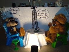 Add some unexpected humor to the reception.  The bride and groom's bear missed the wedding because he was playing poker with Wile Coyote, the wedding planner.  This is actually placed right in front of the bride & groom's table.  Each wearing home-made zebra bow ties.