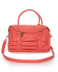 Coral is becoming my thanngg. And the inside of this purse is gorg.