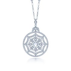 Centered on a classic rose cut diamond, layers of pave diamonds shape the opulent pendant. The chain is 16 inches in length. Style No. 28905