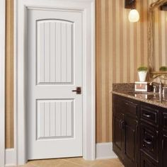 JELD-WEN Smooth 2-Panel Arch Top V-Groove Solid Core Primed Molded Interior Door Slab-THDJW137500016 at The Home Depot
