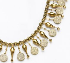 A micromosaic and high karat gold necklace, Castellani, circa 1870  the woven chain necklace supporting a fringe of round, white micromosaic pendants alternating with amphora-shaped pendants and gold beads; maker's mark for Castellani; length: 16in.