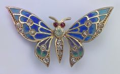 ART NOUVEAU Butterfly Brooch  Gilded silver Plique-à-jour enamel Paste H: 2.6 cm (1.02 in)  W: 4.9 cm (1.93 in)  Marks: Eagles head & Indisctinct makers mark French, c.1905