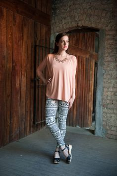Blush top, statement necklace, and funky leggings!