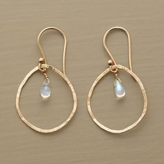 LET IT RAIN EARRINGS -- Moonstones give off rainbows within raindrops hand formed of 14kt gold. French wires. Exclusively ours by Anne Sportun. 1-1/4L.