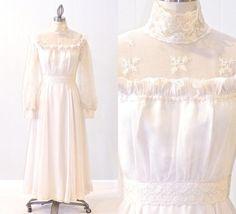 Vintage 1970s Edwardian Style Wedding Dress by daisyandstella on Etsy, $135.00  https://www.etsy.com/listing/184240357/vintage-1970s-cream-wedding-dress-70s