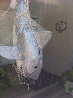 Pinner had this as a Shark Party Decoration....I would rot the shark, show some rib bones, and make it thrash when someone walked by...muhahahah