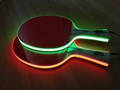 """This glowing table tennis paddles are called """"Light Tape Table Tennis Bats"""". It would be amazing when you are going to play at a slightly dim area using this kind of bat."""
