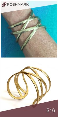 NWT Fair Trade Criss Cross Cuff in Gold NEW Criss cross style Cuff and gold tone plated brass. Adjustable to fit any wrist size. Handcrafted at an artisan cooperative in North India. Dress up or down. Wear with the Geometric Tank and Skirt - see separate listings. Only one left! Mata Traders Jewelry Bracelets