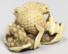 A Japanese ivory okimono netsuke, with signature Okatomo, 19th Century of two quail standing on leafy millet and busy feeding their three hungry young, signed on a rectangular reserve -- 2 3/8in. (6cm.) wide.