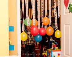 hang balloons attached to streamers in your child's bedroom doorway the morning of his birthday