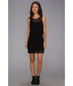 Crochet-knit dress flaunts a crossover cutout at back.. Removable tonal lining.. Round neck and sle...