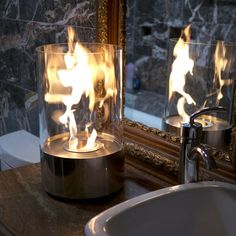 Nu-Flame  Eco-friendly ireplaces ____Because who doesn't want flames in their bathroom