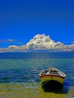 Lake Titicaca, between Peru and Bolivia,  3800 meters -12500 feet above sea level... you can rent a boat and sail the highest lake in the world