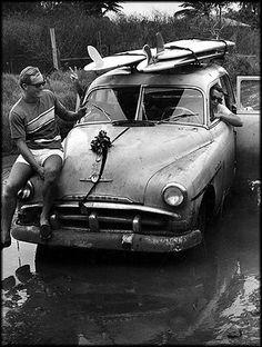 Bruce Jones (surfboard shaper) sitting behind the wheel of Leo Hetzel´s Plymoth 1965, Ke Iki Road, North Shore, Oahu!