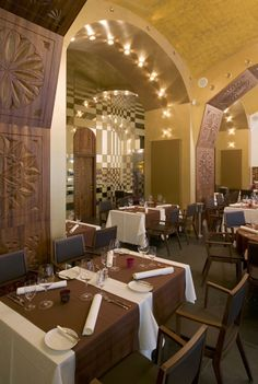 """Dió Restaurant & Bar ~ At this """"trendy"""" Hungarian in Lipótváros, """"old-fashioned favorites"""" are """"imaginatively"""" adapted to """"21st-century preferences"""", with a """"lighter, healthier"""" result; the name translates as 'walnut', and that warm wood turns up in fanciful folkloric carvings set against a """"stylish"""" backdrop of """"glittering"""" mirrors and chandeliers.  #Budapest #Restaurant #Hungarian"""