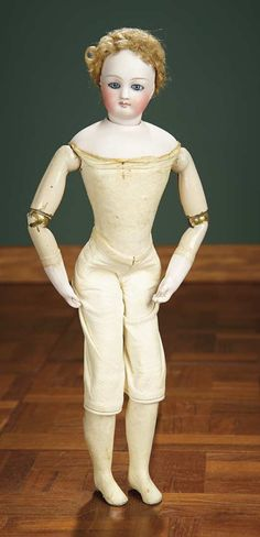 """French Bisque Poupee by Barrois with Rare Luxury Body from Original Cruchet Deposes 2800/3700   French stretched-kid-cover wooden body, with metal-hinge hip jointing covered by kid """"baggy"""" upper legs, metal upper arms, bisque forearms, jointing at shoulders, elbows, hips and knees. Condition: generally excellent. Marks: E.2 B. (shoulderplate). Comments: French, circa 1867, with original commissioned bisque head by Eugene Barrois, the model of the doll's body was inspired by deposes…"""