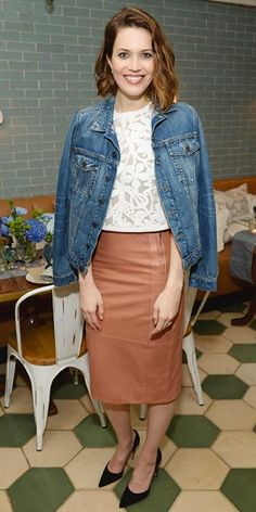 23 Ways to Style a Denim Jacket, Inspired by the Stars | InStyle.com Mandy Moore gave her ladylike Tanya Taylor separates-a white floral crop top and caramel leather pencil skirt-a casual spin by draping a denim jacket over her shoulders.
