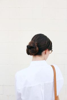 Keep a low profile with a classic, cool bun.