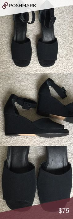 """Black Fabric wedges Anne Klein brand Made  Italy Nearly perfect black matte fabric wedges. They are from 1990 Anne Klein and I only wore them a couple of times. I've kept them all these years in a plastic box and they are classic and super comfortable! The wedge is 2 3/4"""" with a 1/2"""" platform at front. Made in Italy Anne Klein Shoes Wedges"""