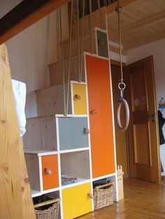 What if you did this.. leading up to the overhead storage space in garage? stairs to loft bed