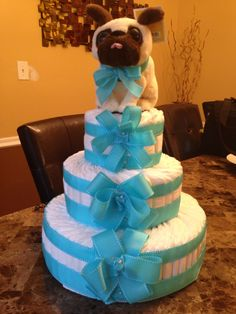 Three tiered pamper cake. Adorned with a cute puppy topper. Perfect for a baby shower...so much better than giving a box of pampers.