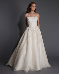 """A classic ball gown with lace appliqués and a straight-across neckline is a fresh take on the classic sweetheart.Modern Trousseau """"Odette"""" A-line dress, $4,005;moderntrousseau.com."""
