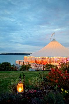 How picturesque is this Maine wedding venue? Love the tent, love the lantern, love the view! {Frenchs Point}