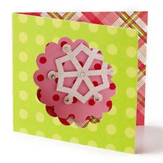 Holiday Gift Tag—Add dimension to your gift tags: fold tag in half, cutout/punch scalloped circle in center of front side, center & adhere snowflake inside on back panel to view through cutout.