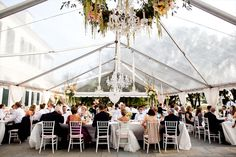 LOVE floral around chandelier... also love the two really tall center pieces