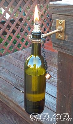 Make unique decorative tiki torches out of glass wine/beer/soda/olive oil bottles-special wick holder!