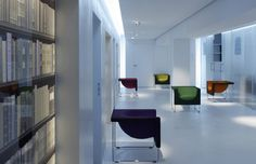 Office lobby with STUA Nube armchair in colors.