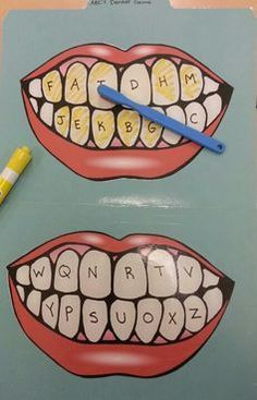 A dental-themed ABC game I made. The kids used a yellow dry-erase marker to color 'plaque' on the teeth. Then, they used alphabet dice (alphabet flash cards would work too) to match letters. They had to brush the matching alphabet tooth clean. They loved it!