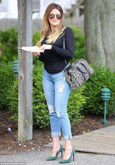 Khloe Kardashian caught the eye in a pair of on-trend ripped jeans and a wild bag http://dailym.ai/1kqcyhO