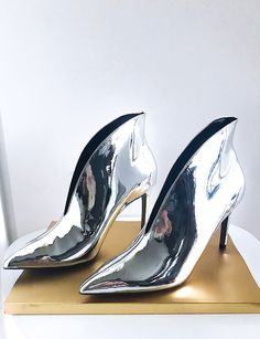 How beautiful these Silver mirrored boots are shining next to Gold, right? According to @whowhatwear, these boots have been all over Fashion Week 2017. Find them on ...