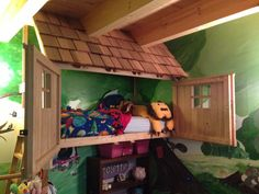 Tree house bunk bed. Cherry wood construction, red cedar shingle roof. The front opens for easy access and locks for safety. The bunk bed has a built in slide.