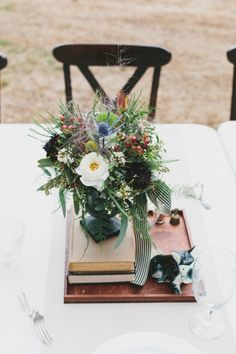 Vintage centerpieces. Photography by brettjessica.com Read more - http://www.stylemepretty.com/2013/08/09/north-carolina-farm-wedding-from-brett-jessica-and-orangerie-events/