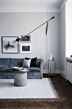 Sitting room in monochrome and indigo. Flos 265 light....