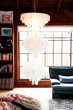 A living room featuring a large chandelier made of shells.  #currentlycoveting #holidays2015 #holidaze #holidaystyle