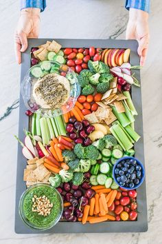 Taylor Farms Tastebud Touchdown What's a party without a festive veggie and dip board? We're loving this colorful one made with Taylor Farms Organic Veggie Trays and served with Mint Spinach Pesto! Party Food Platters, Veggie Platters, Veggie Tray, Charcuterie Recipes, Charcuterie Platter, Healthy Appetizers, Healthy Snacks, Catering Food, Catering Display