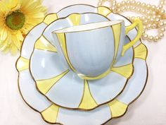 Charming Allertons Old English fine bone china tea trio. Exceptionally unique bone china tea set produced between 1929-1942 by Charles Allertons & Sons of the Park Works, Longton, Staffordshire. The set is beautifully hand decorated with soft blue and yellow panels and brown details creating the impression of simple flowers. How can you resist the coziness a hot cup of tea makes you feel when its coming from an exquisite vintage teacup? Can be used for tea parties, weddings, formal dinner...