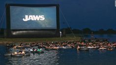 Jaws on the Water - The Alamo Drafthouse Rolling Roadshow invites brave movie goers to view Steven Spielberg classic Jaws which turns 40 this year, on a giant screen as they float in inner tubes over murky waters.