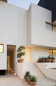 Modern White Architecture -- white stucco with smooth texture looks more modern
