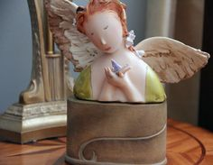 angel with bird in hand so peaceful