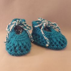Blue knitted baby booties $8.99 Our Knitted baby booties keep your baby's little feet warm and comfy. They're knitted from soft wool that doesn't irritate your baby's skin. Material: 100 % Acrylic. Sizes from Newborn to 12 months.