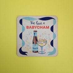 """Sweet little coaster showing the Babycham deer leaping on one side and the words """"I'd Love A Babycham"""" on the other. In reasonable condition overall with some usage wear to top corners (pictured) and approximately 9cm squared, fairly standard coaster size.All items are authentic vintage goods, specially selected for robertafidora.com and as such, items may show signs of wear consistent with age and use."""