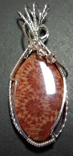 Fossil Coral wrapped in Sterling Silver By Toribeth Designs