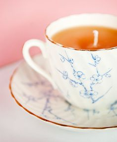 candles in teacups.  david and i could do this and then attach a teabag onto it of our homemade tea!  win.