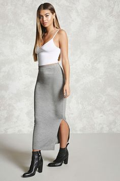 Style Deals - A knit maxi skirt featuring an elasticized waistband and a side slit.