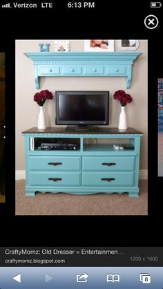 So cute love this color and gives character to any living room. Dresser turned entertainment center is such a great idea!!